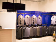 Tailor store. Filled with suits Royalty Free Stock Photo