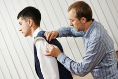 Tailor suit fitting Stock Image