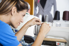 Tailor Threading Needle Of Sewing Machine Royalty Free Stock Photography