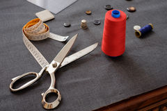 Tailor tools isolated on piece of fabric Stock Photo