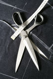 Tailor Tools of Trade - Scissors and Tape Measure. Royalty Free Stock Images