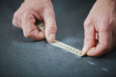 Tailor Using Measuring Tape in Atelier Royalty Free Stock Photo
