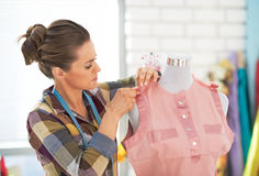 Tailor woman with working on clothes in studio Royalty Free Stock Photo
