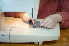 Tailor work. Working from home, beautiful drapes and the remarkable curtains tailor at work Stock Photography