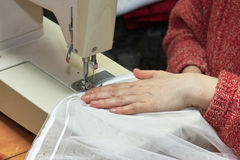 Tailor work. Working from home, beautiful drapes and the remarkable curtains tailor at work Stock Photos