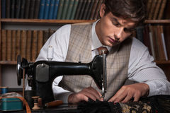 Tailor at work. Confident young man working at the tailor shop royalty free stock photos