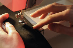 Tailor at Work on Sewing Machine Stock Images