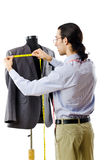 Tailor working. On the white Stock Photography