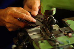 Tailor working on a cutting machine at textile factory Royalty Free Stock Image