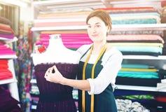 Tailor working at dress Stock Photos