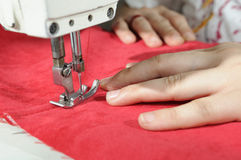 Tailor working at a factory. Tailor working at a textile factory royalty free stock photos
