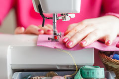 Tailor working on a sewing machine Stock Photo
