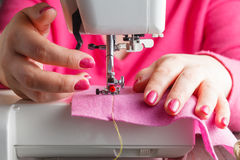 Tailor working on a sewing machine Stock Image