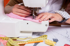 Tailor working on sewing machine. Royalty Free Stock Image