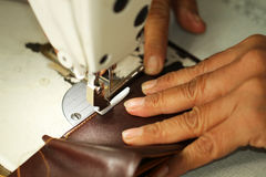 Tailor working on a sewing machine at textile factory royalty free stock image