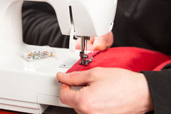 Tailor working on sewing machine Royalty Free Stock Photography