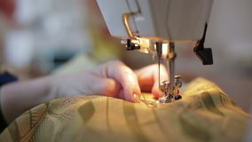 Tailor works on sewing machine stock video footage