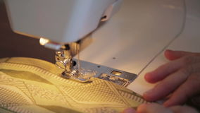 Tailor works on sewing machine stock footage