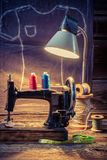 Tailor workshop with sewing machine and cloth Royalty Free Stock Photography