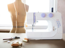 Tailor workshop with white sewing machine, fashion dummy, detail Royalty Free Stock Photos