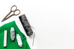 Tailor workspace with sewing and handmade tools white desk background top view mock up Royalty Free Stock Photos