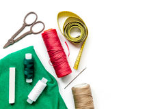 Tailor workspace with sewing and handmade tools white desk background top view mock up. Tailor workspace with sewing and handmade tools on white desk background Royalty Free Stock Photo