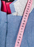 Tailoring of collar for blue jacket on dummy Stock Image