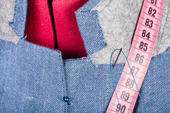 Tailoring of collar for silk jacket on mannequin Royalty Free Stock Images