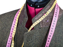 Tailoring of collar for tweed jacket on mannequin. Isolated on white background Royalty Free Stock Photo