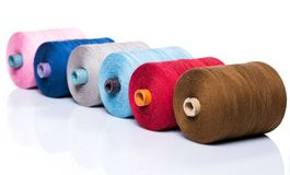 Tailoring. Colorful threads on white background Stock Photos