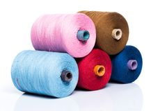 Tailoring. Colorful threads on white background Royalty Free Stock Photography