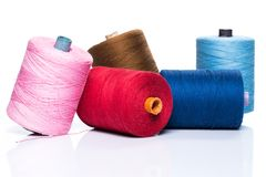 Tailoring. Colorful threads on white background Stock Image