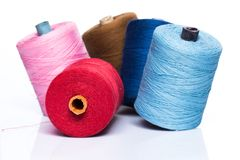 Tailoring. Colorful threads on white background Stock Images