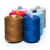Tailoring. Colorful threads on white background Royalty Free Stock Image