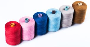 Tailoring. Colorful threads on white background Stock Photography