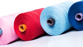 Tailoring. Colorful threads on white background Royalty Free Stock Images