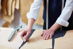 Tailoring Craftsman Working in Atelier Royalty Free Stock Image