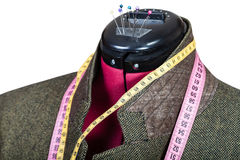 Tailoring of male green tweed jacket on mannequin Royalty Free Stock Photography