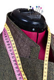 Tailoring of male woolen tweed jacket on dummy Stock Images