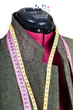 Tailoring of man tweed jacket on mannequin Stock Images