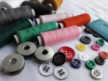 Tailoring matirial thread spools, buttons, chalk, rolls stock images