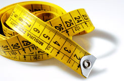 Tailoring measure. Yellow on a white background Stock Image