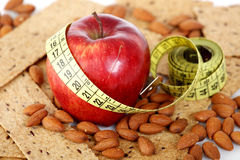 Tailoring meter with biscuits and almonds Royalty Free Stock Images