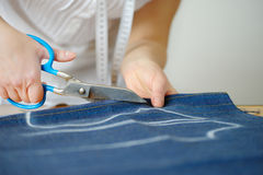 Tailoring of natural wool. Woman tailors sewing fabric. Royalty Free Stock Photo