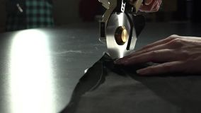 Tailoring process. Cutting cloth with electric circular knife. Handcrafted manufacturer concept stock video footage