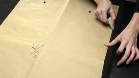 Tailoring process - patterns and chalk stock video