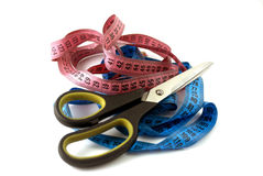 Tailoring scissors and colored meters Stock Photos