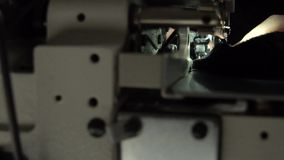 Tailoring on the sewing machine. Slow motion close up stock video footage
