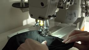 Tailoring on the sewing machine. Slow motion close up stock video