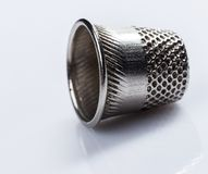 Tailoring. Thimble, also known as finger guard Stock Image